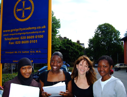 Lynne Featherstone with Inas Himedan, Taimmy Hango and Janet Kanyange outside Greig Academy