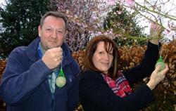Lynne Featherstone feeding birds with Tim Webb