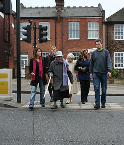 Lynne Featherstone crossing North Hill with Highgate councillors Bob Hare and Rachel Allison plus local pensioners
