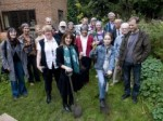 Lynne Featherstone planting trees with residents