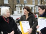 Lynne Featherstone and Katherine Reece surveying a local resident in Stroud Green about her access to GPs