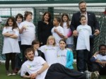 Lynne Featherstone MP and Jonny Gould with students at the new games area at TreeHouse