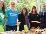 Lynne Featherstone MP (Centre) with Barclays and Macmillan staff in Barclays, Wood Green