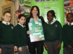 Lynne Featherstone at Oxfam (Wood Green) with four children from St Michael's Primary School