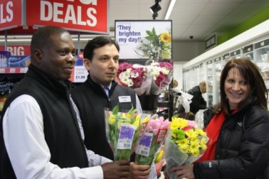 Lynne Featherstone MP with Adnan Naqvi and co-operative staff in the Cooperative store on Tottenham Lane