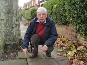 Cllr Jim Jenks on Priory Avenue, N8,  inspecting one of the many broken and uneven pavements in Haringey