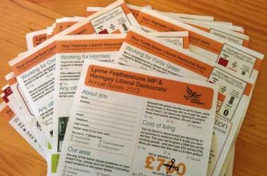 a pile of the MP's annual surveys