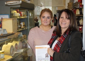 Lynne Featherstone MP with nomination forms in an independent shop