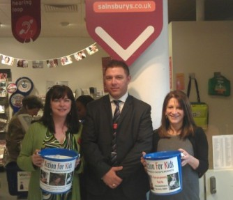 PR Ambassador Catherine Ling, Store Manager Richard Bannister, and Lynne Featherstone MP with charity collection buckets, at the front of the Sainsbury's Muswell Hill store