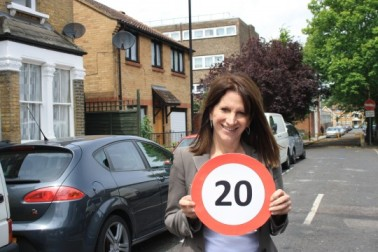 Lynne Featherstone MP with a 20mph sign on a street in Hornsey