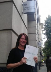 Lynne Featherstone MP outside the Department for Transport, holding the document which confirms there will be no losses of services at Hornsey and Harringay