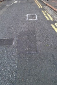 Lightfoot Road in Hornsey, where a man suffered brain injury as a result of tripping in a pothole. Some potholes have been filled but others (which had been marked for repair) were left untouched.