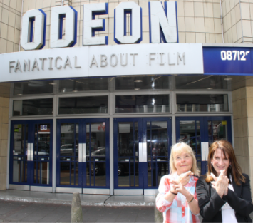 Lynne Featherstone MP and Councillor Gail Engert keep their fingers crossed for the new police front counter at Muswell Hill Odeon to be opened