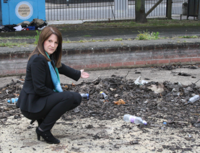 Lynne Featherstone MP inspecting the rubbish at the old pond