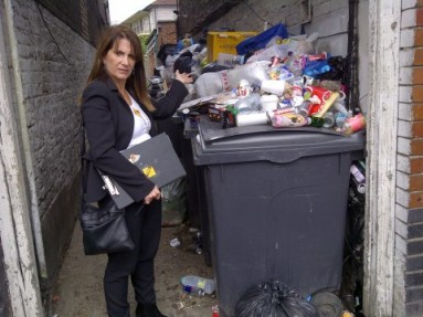 Lynne Featherstone MP on Lordship Lane, with the pile of uncollected and dumped rubbish