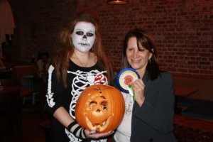 Lynne Featherstone gives out rosettes for the best carved pumpkins