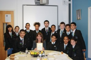 Lynne Featherstone MP with the Woodside High school children, and the picture they presented her.