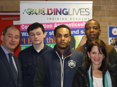 Lynne Featherstone MP with Communities Minister Stephen Williams MP (left) and apprentices from Building Lives.