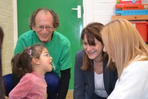 Lynne Featherstone MP and marathon runner David Schmitz with LCCP pupil Amani