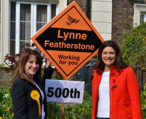 Lynne Featherstone and Miriam Gonzalez Durantez with the 500th Lib Dem stakeboard